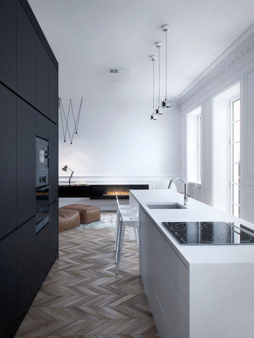 Black modular furniture set at the white kitchen island in the open layout apartment