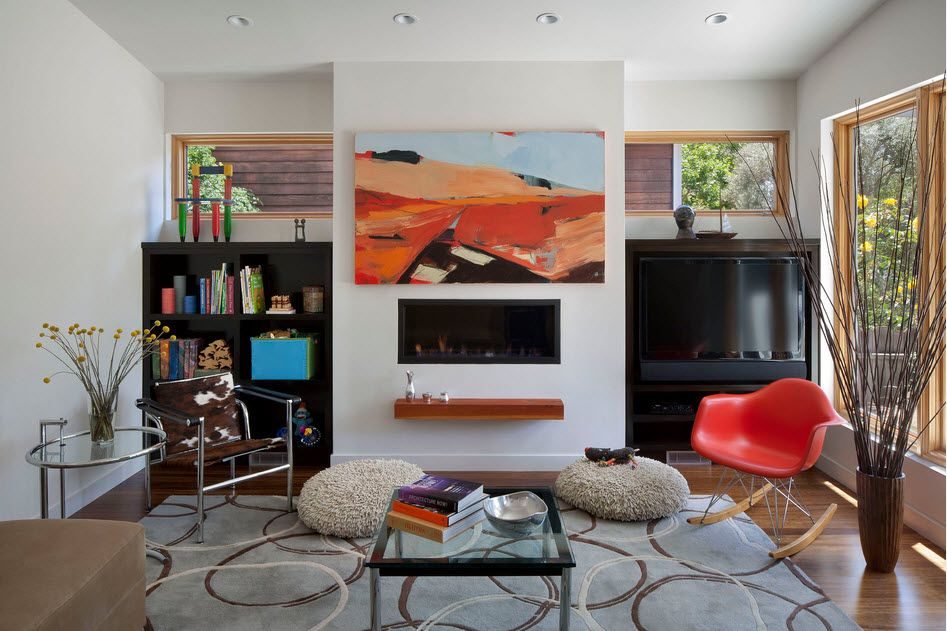 White accent wall with the shelf and the fireplace as if it is TV-set