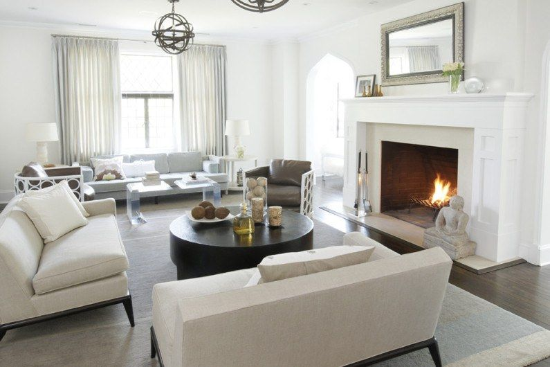Coffee white living room with organically inscribed fireplace decorated with mirror