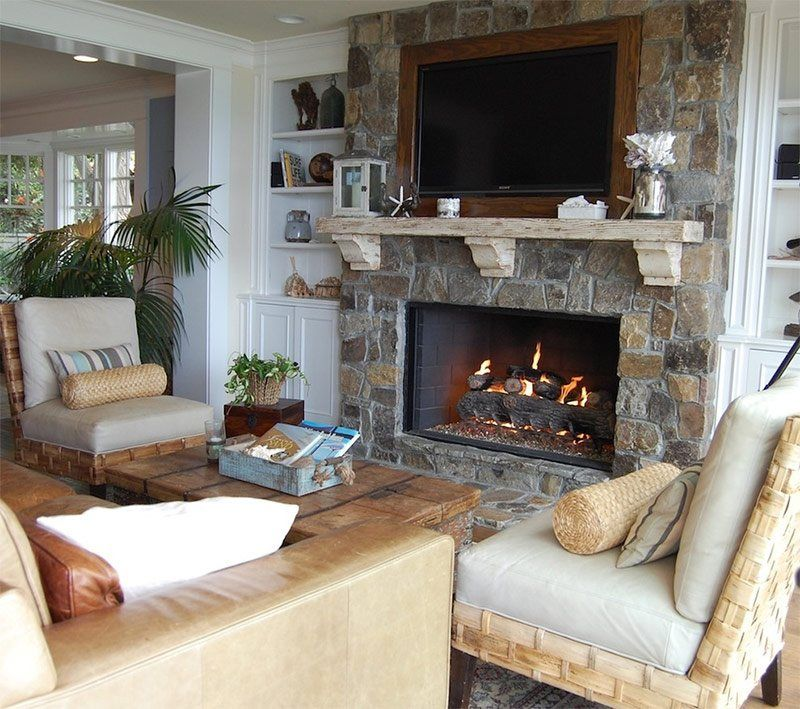 Stone trimmed accent wall with shelf, TV and the fireplace