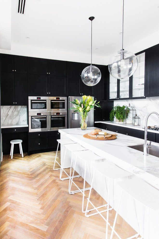 Black and White Interior Combination: Elegant Contrast in Different Rooms. Varnished parquet in the contemporary kitchen with large white island