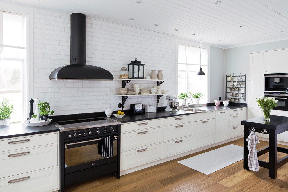 Simple & concise contemporary design of the kitchen with dark extractor hood