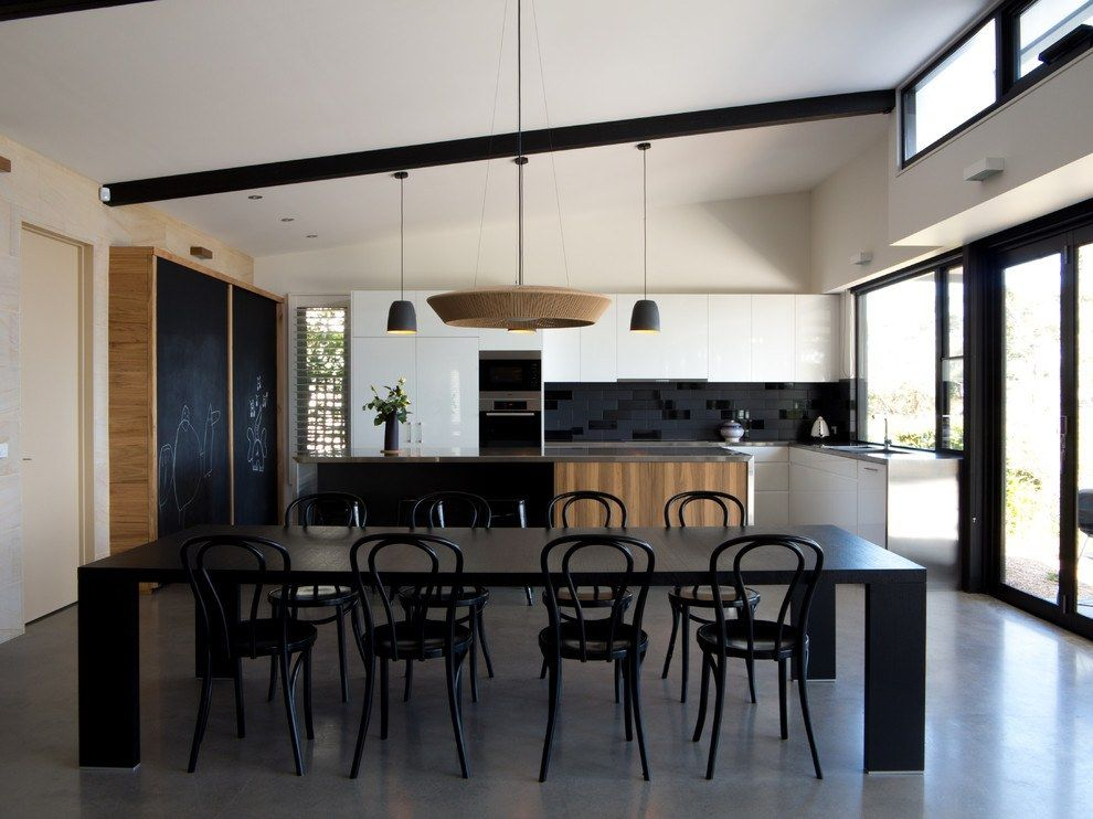 Large kitchen successful modern design with dark furniture and floor
