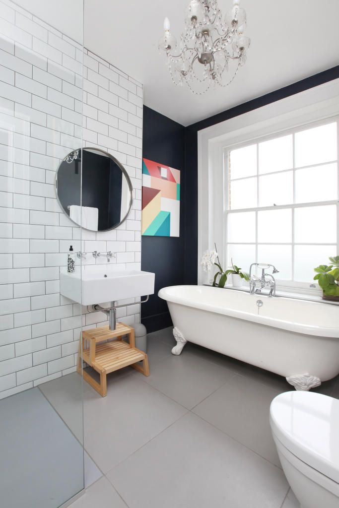 Shabby Chic bathroom design with dark accent wall and colorful impressionistic picture on it