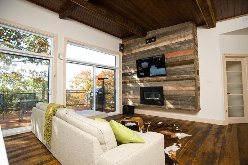 Plank-decorated accent wall with small fireplace and TV