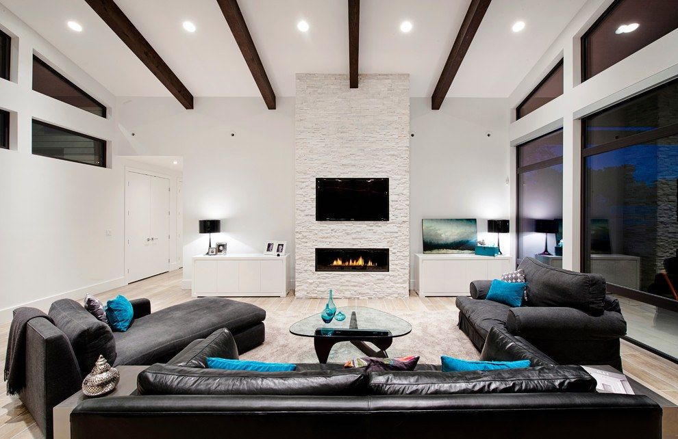 Minimalistic and beautiful design of the modern version of American style in the living room with open dark ceiling beams