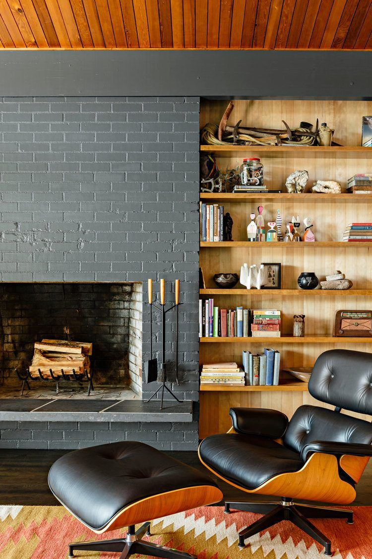 Eames chair and library shelving for reserved style of Classic living room
