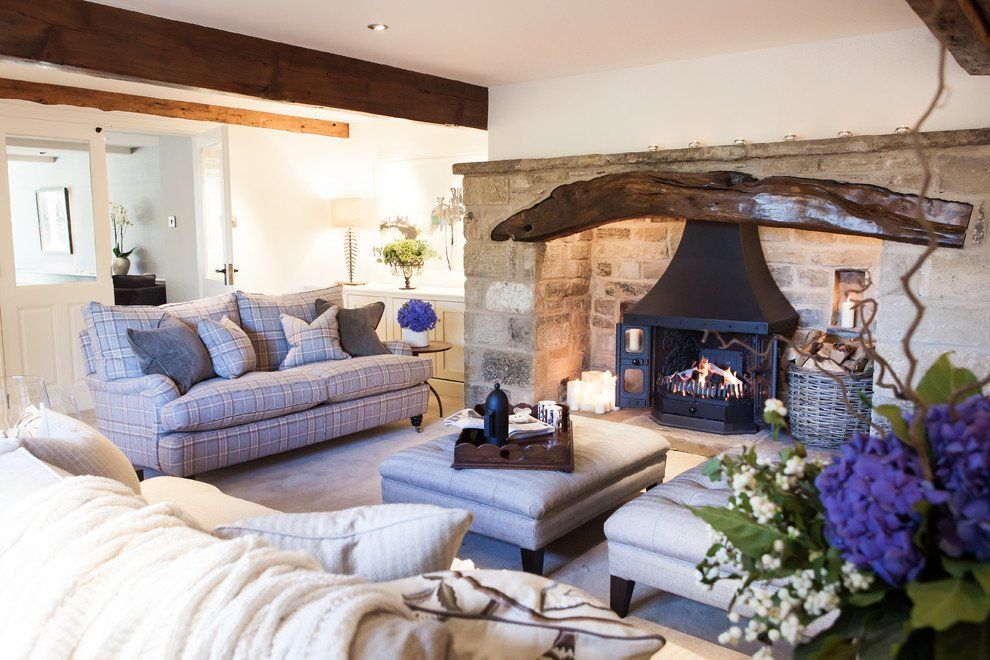 Wooden log over the Classic styled fireplace