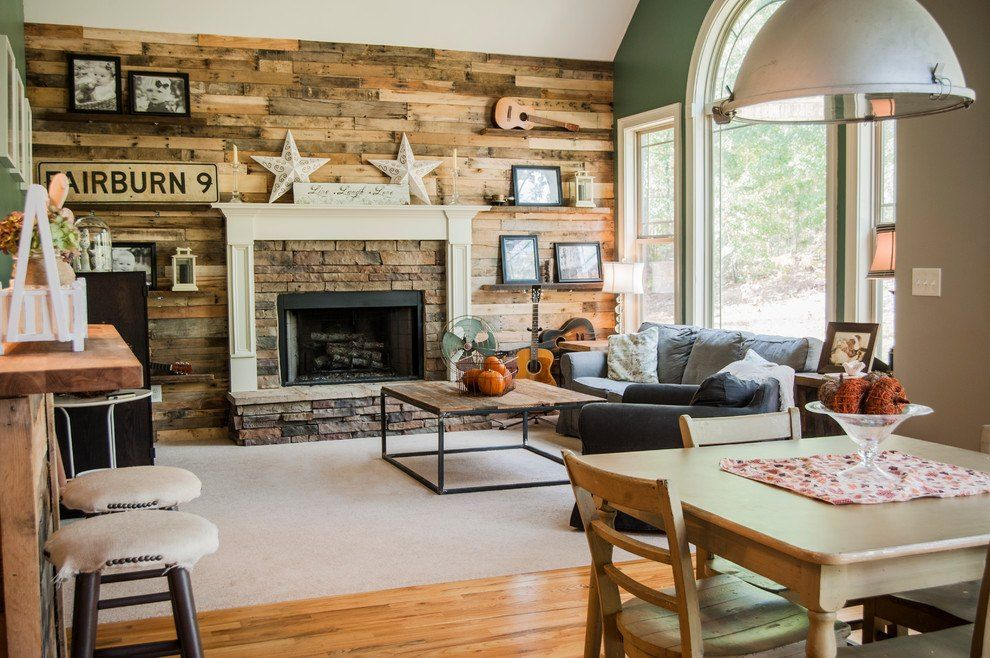 Wooden planked accent wall with concrete framing around hearth