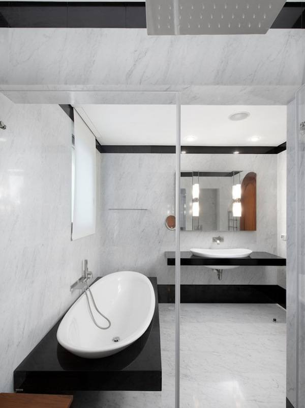 Ultramodern bathroom interior with mirror, large oval sink