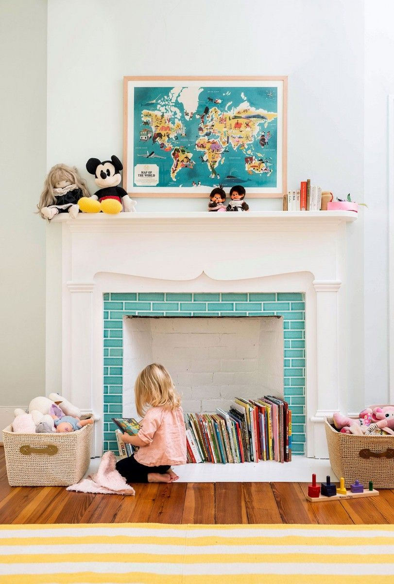 Kids' room with toys and the fireplace