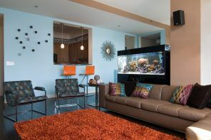 Black aquarium in the colorful living room