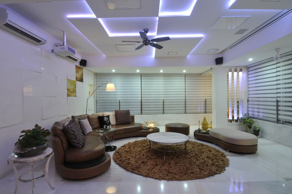 Complex paneled ceiling with LED backlight for modern white colored living room