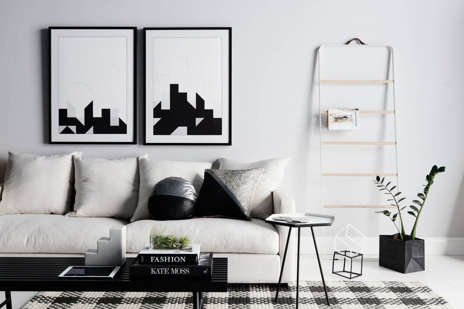 Living room with black and white pictures as well as contrasting interior elements