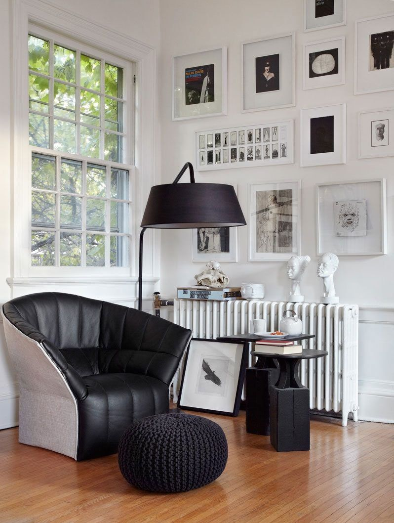 Mid-century stylistic in the living room with photos at the wall
