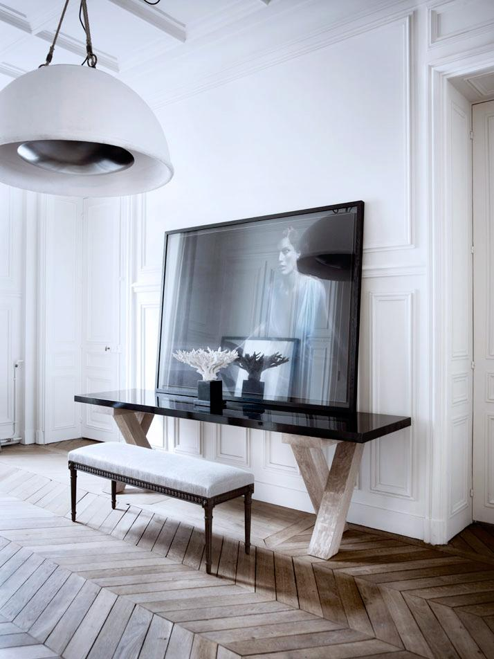 Black mirror at the boudoir zone of the light colored room with parquet