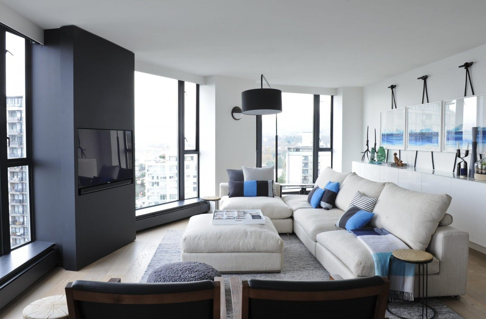 Black and White Interior Combination: Elegant Contrast in Different Rooms. Large semi-circular form of the large living room in open layout apartment