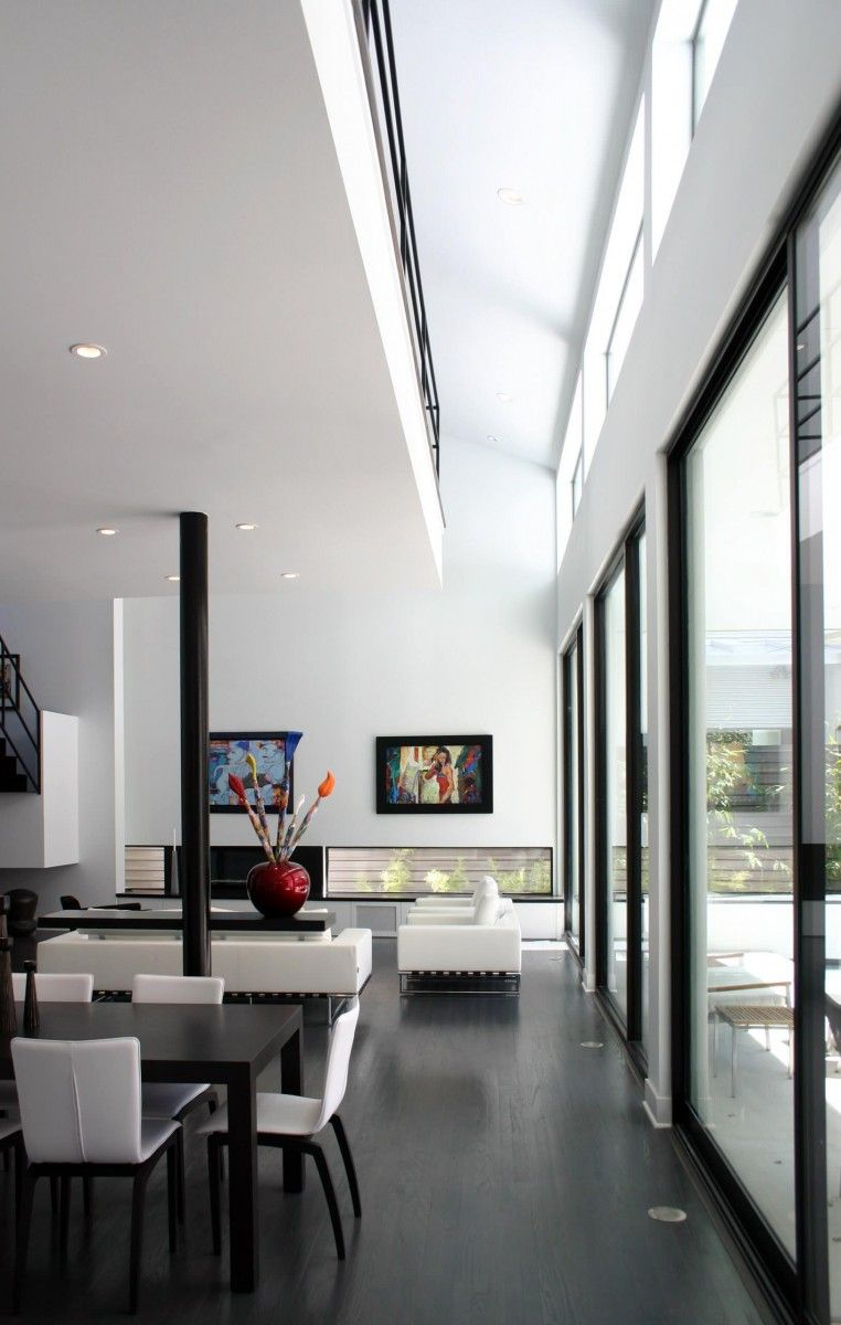 High ceilings and panoramic windows at the ideally white room with dark accents