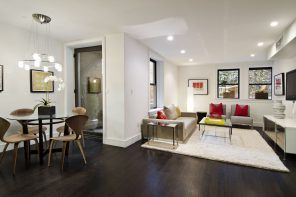 Dark floor and light colored walls for open layout condo