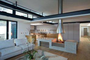 Asymmetric design for futuristic cottage with modular furniture and fireplace right at the cooking zone