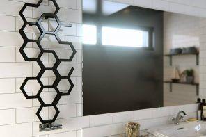 Heated Towel Rail in Bathroom Interior as Practical and Decorative Item. Unusual black honeycomb-looking towel rail for minimalistic bathroom with large mirror