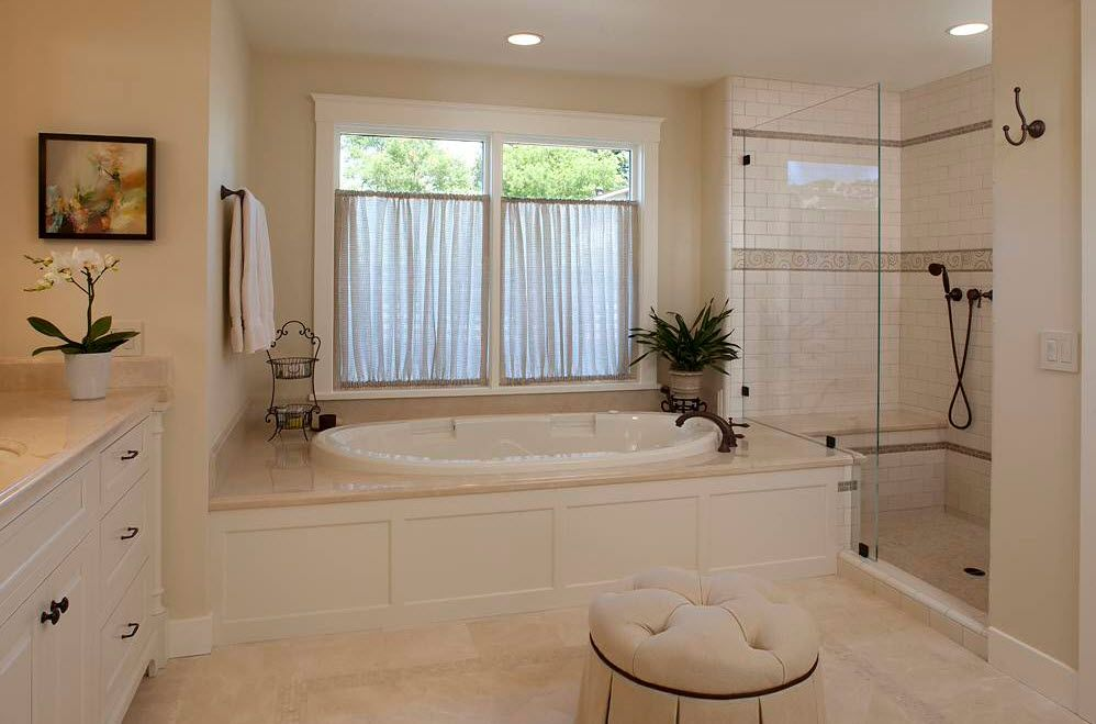Pastel colored royal decorated bathroom with curtains on windows