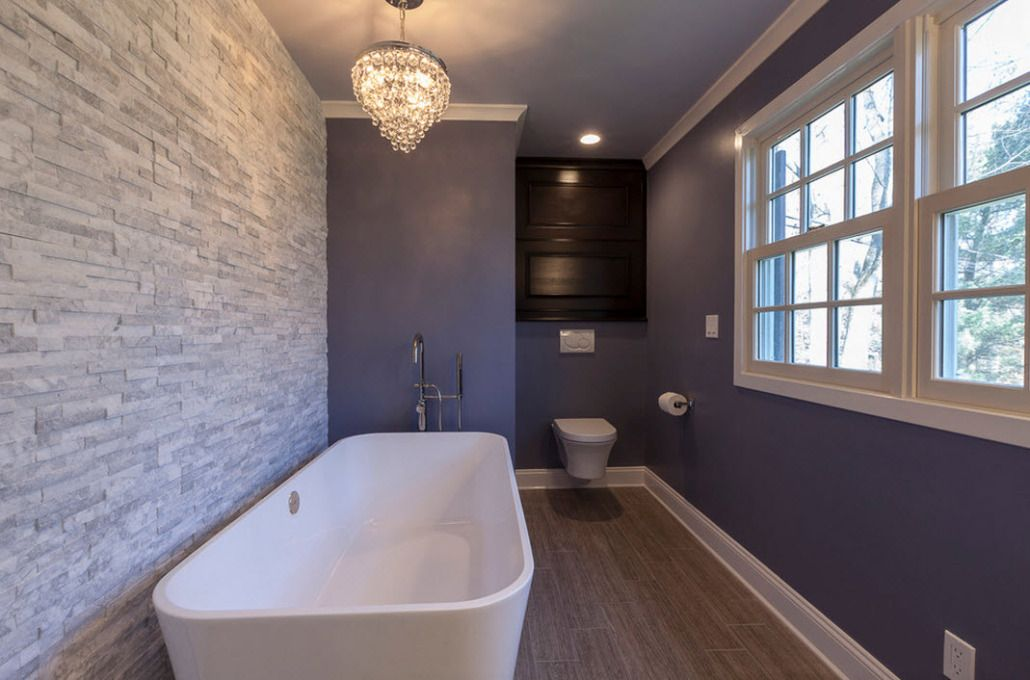 Gray accent wall of natural stone and blue paint at the others