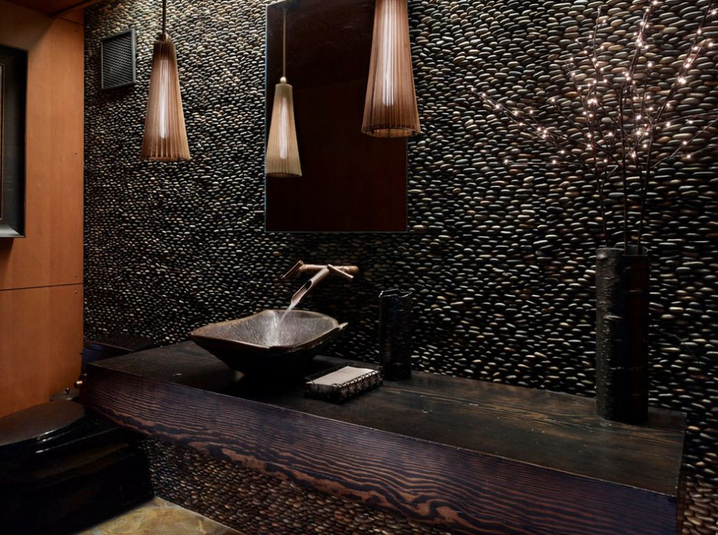 Spectacular dark pebble wall design in ethnic bathroom interior