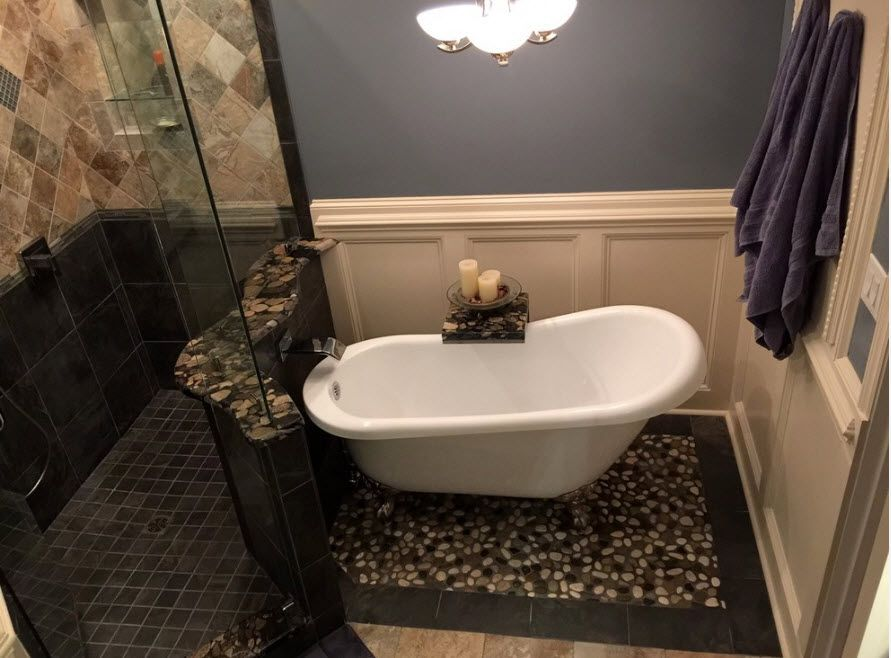 Acrylic Bathtub as the Highlight of Modern Bathroom Interior. African styled atmosphere with Classic form of the bathtub