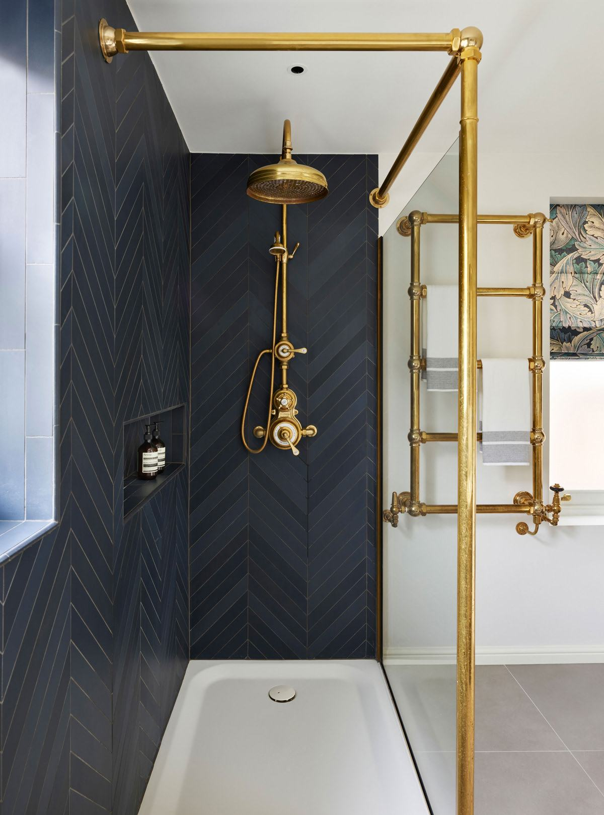 Gilded towel rail in steampunk styled bathroom