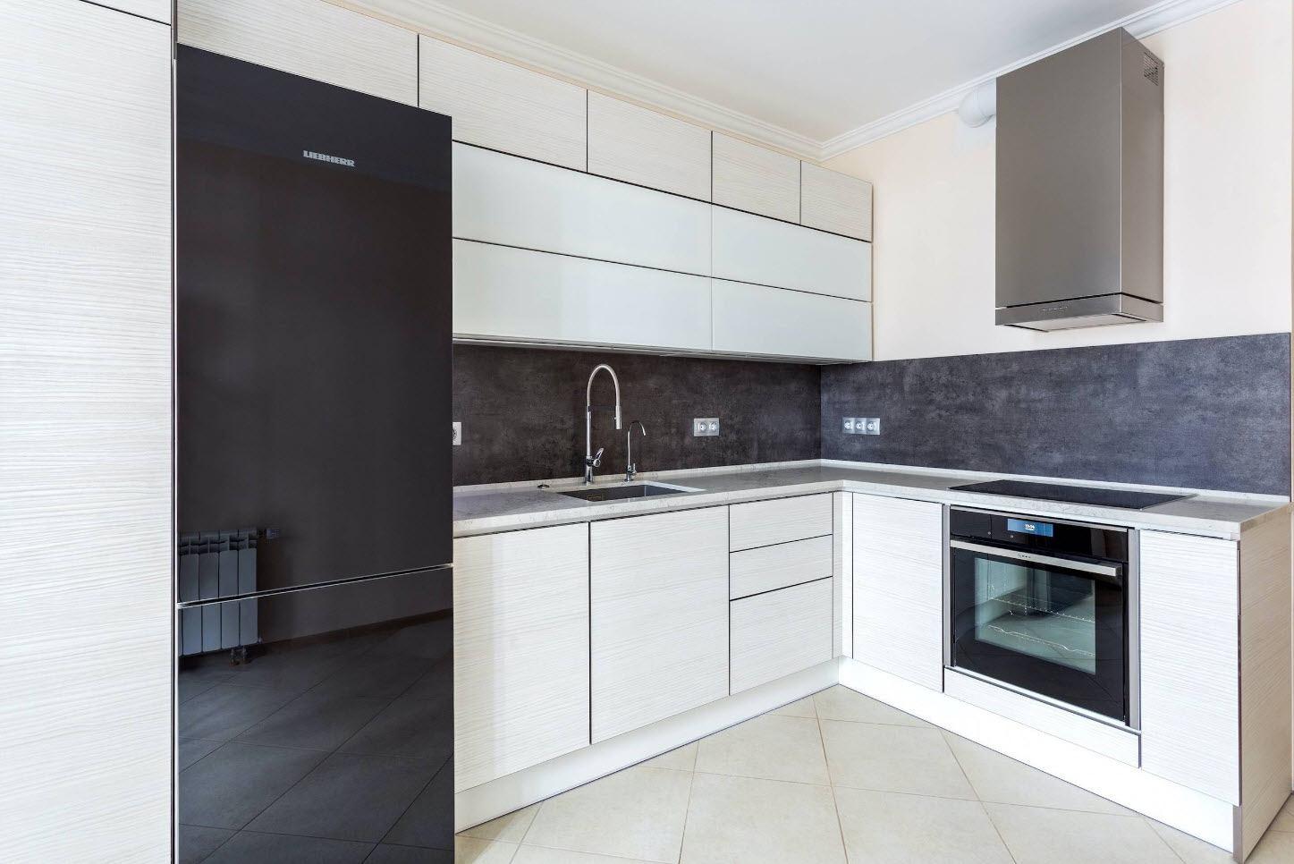 Ultramodern design in white colored kitchen with dark refrigerator