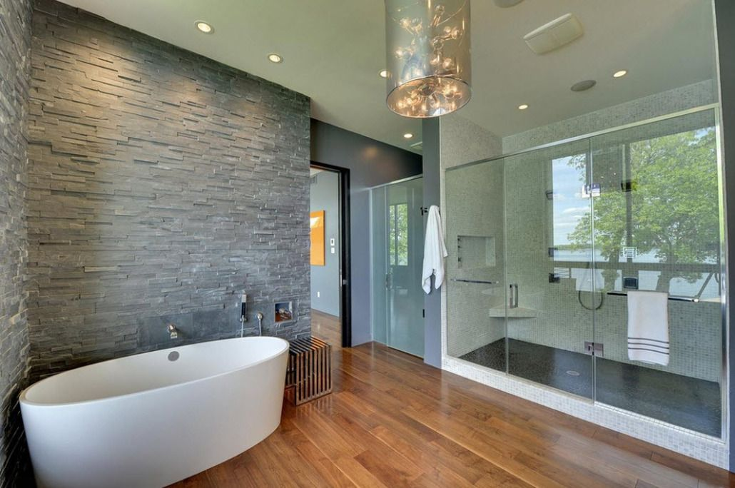 Modern bathroom design with wooden floor and stone at the walls
