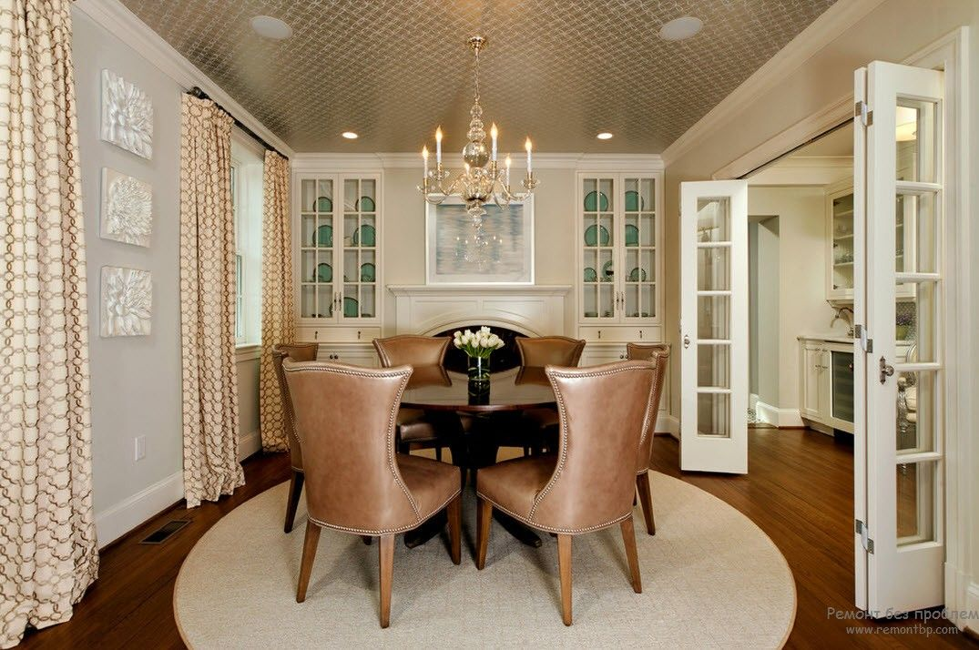 French Interior Design Style Overview. Rounded table and dining zone on the white rug