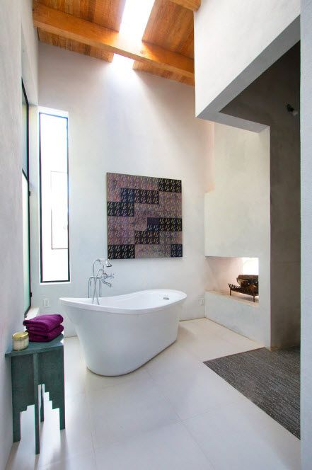 Acrylic Bathtub as the Highlight of Modern Bathroom Interior. Modern styled space with perpendicularly placed ship-looking white bathtub
