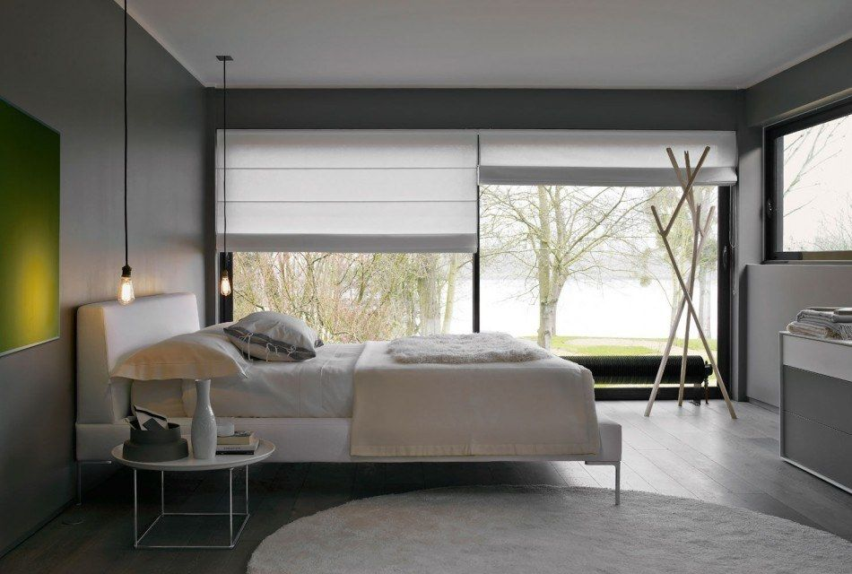 Panoramic window in the fresh minimalistic designed bedroom