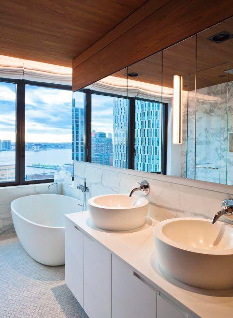 Acrylic Bathtub as the Highlight of Modern Bathroom Interior. Panoramic windows and large mirrors for the ultramodern bathroom design