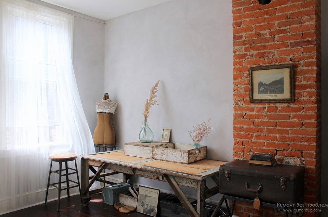 French Interior Design Style Overview. White simple design with brickwork protruding wall