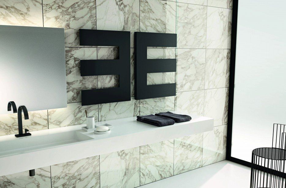 Heated Towel Rail in Bathroom Interior as Practical and Decorative Item. Stylistic arrangement of the heater