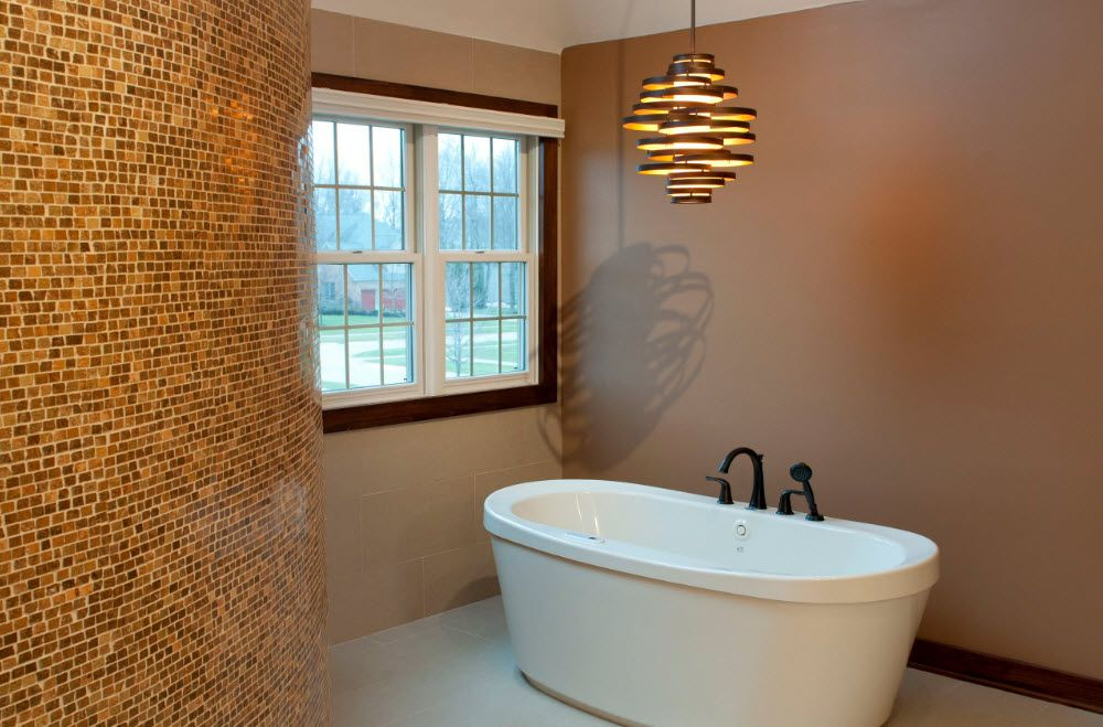 Sandy colored small bathroom with black tap
