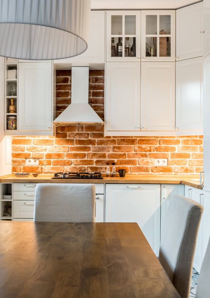 Raw treated bricks results into brickwork at the white colored combined kitchen