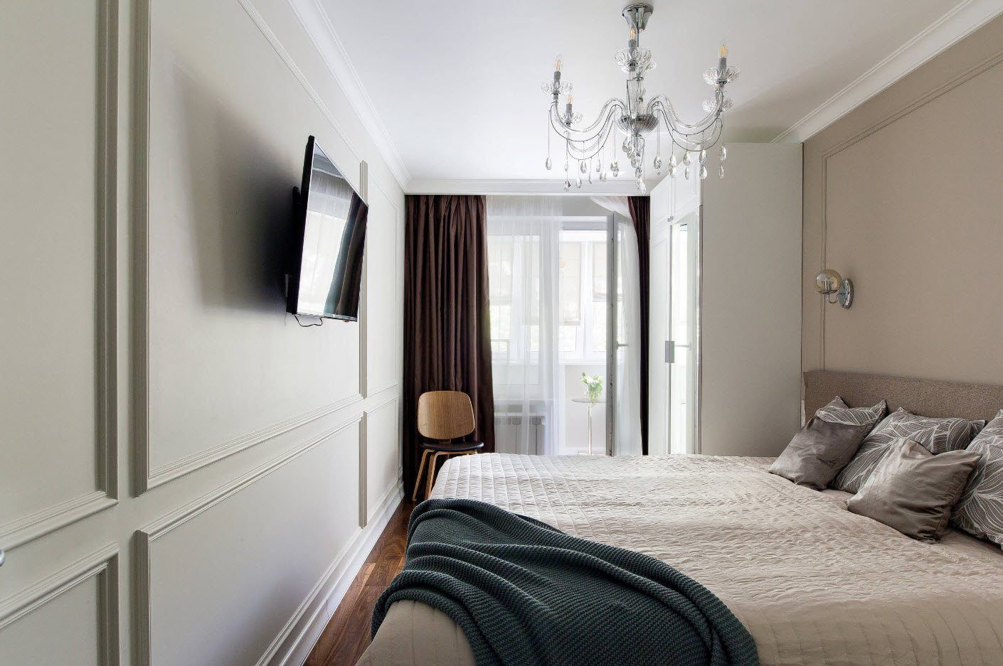 Classic design of the small bedroom with TV and dark curtains