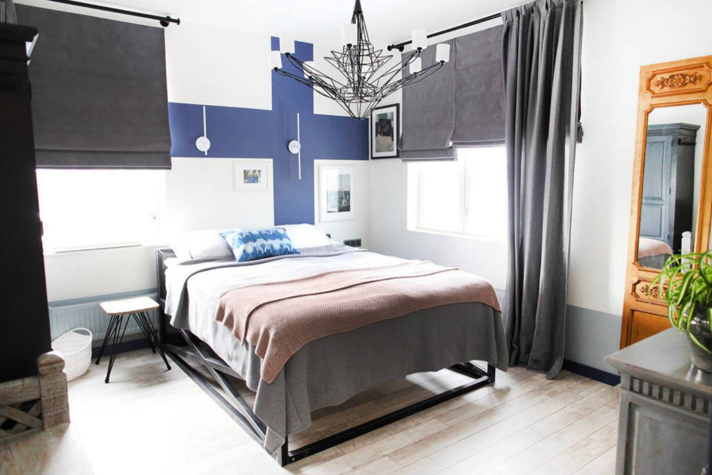 120 Square Feet Bedroom Interior Decoration Ideas. Finnish flag at the wall of Scandi designed room
