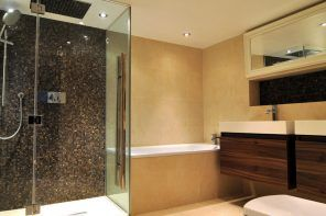 Dark gray pebble wall decoration at the shower cabin