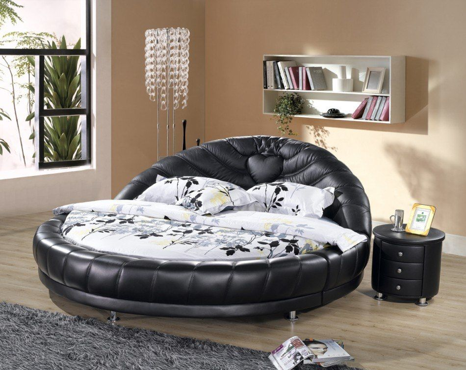 Black round leather upholstered bed in contemporary bedroom