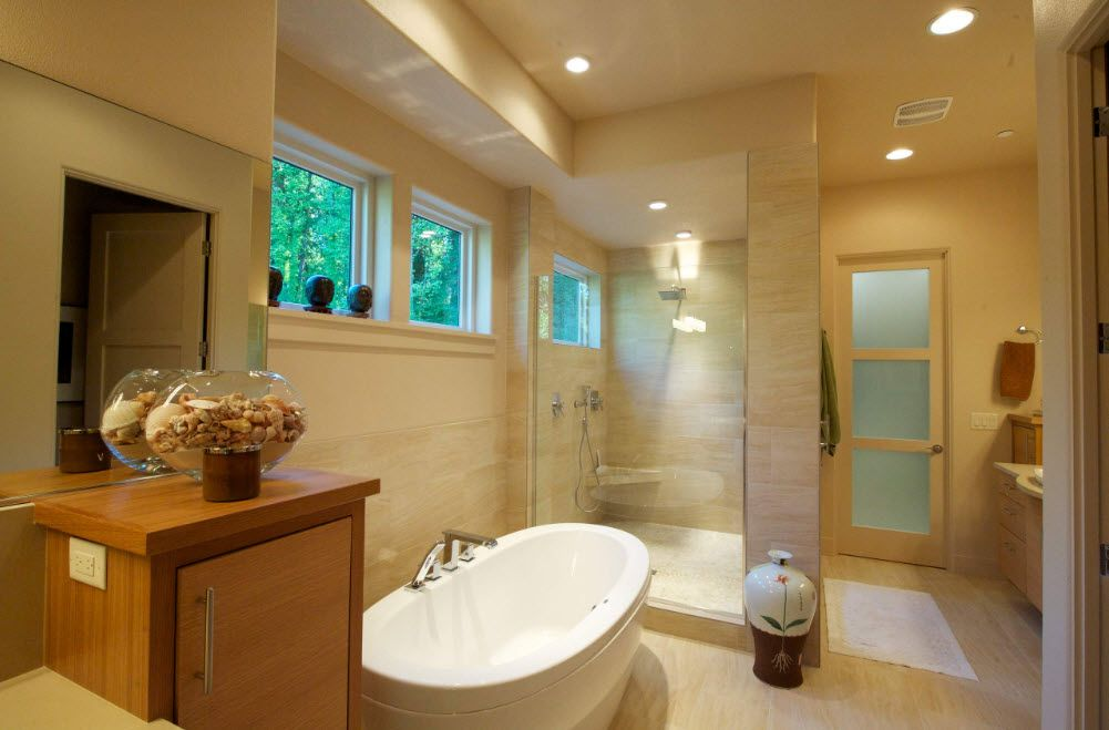 Yellowish tone of the bathroom decoration with shower zone