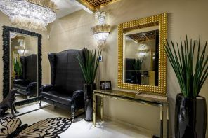 Competent Classic Styled Hallway Design with Photos Examples. Gilded frame of the mirror next to upholstered bench with royal sized backrest