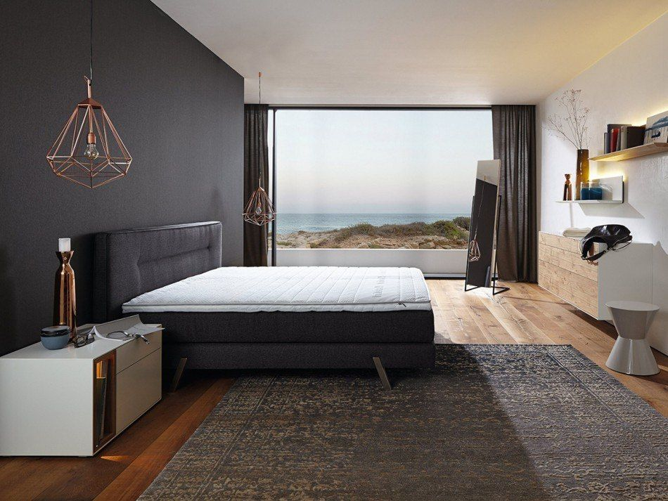 Gorgeous seashore modern styled bedroom with panoramic window and blacout drapes on it