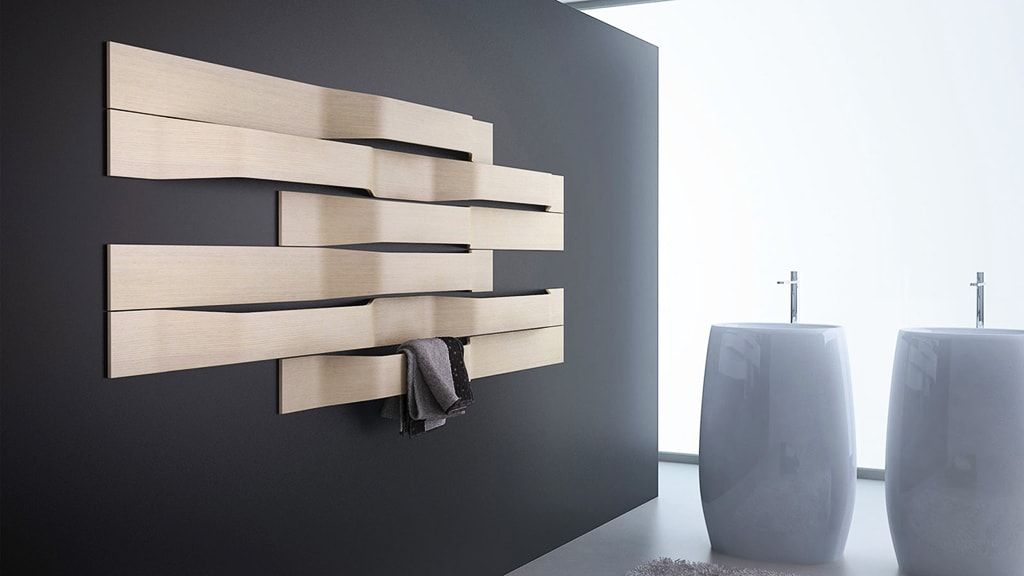 Heated Towel Rail in Bathroom Interior as Practical and Decorative Item. Gray wall and textured wall installation with different levels of rails