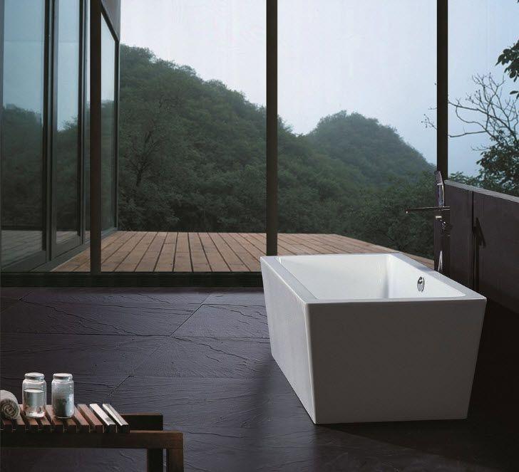 Acrylic Bathtub as the Highlight of Modern Bathroom Interior. Square bathtub in the oriental styled bathroom with dark floor and deck
