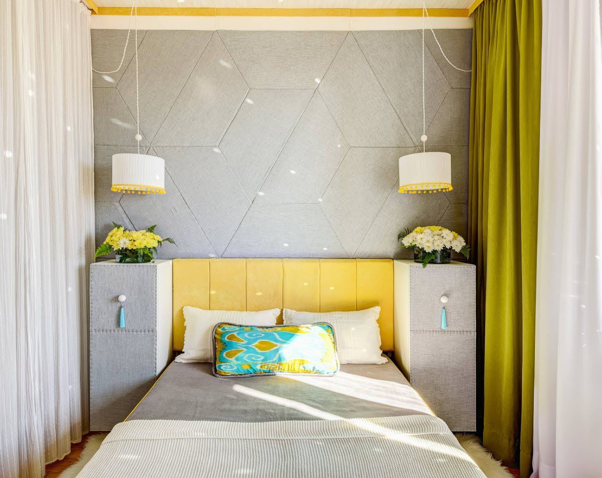 120 Square Feet Bedroom Interior Decoration Ideas. Overloaded bed headboard with lamps, storage and quilted yellow upholstery